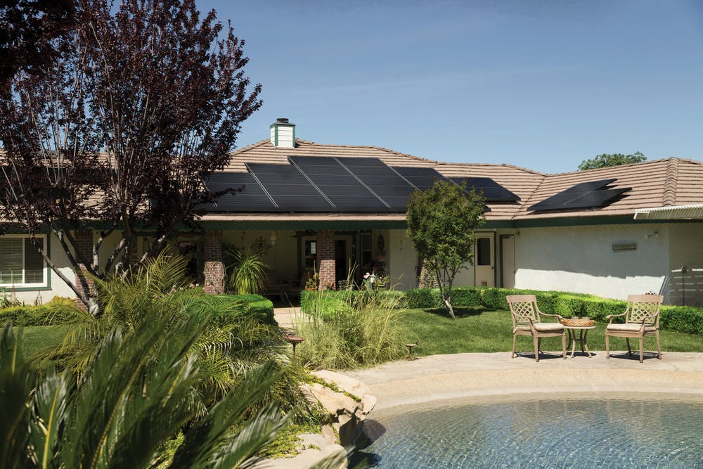 solar panels in the roof of a home