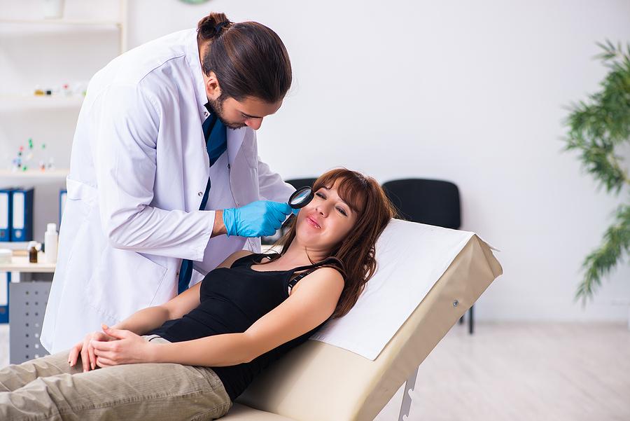 Dermatologist doing a mole mapping